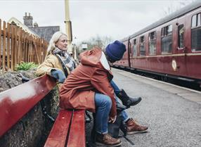 Couple waiting on train platform
