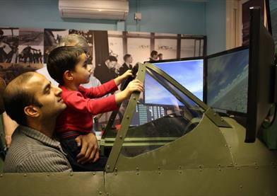 Maidenhead Heritage Centre: man and boy enjoying the Spitfire Simulator